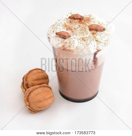 Glass of hot chocolate with whipped cream isolated on white background