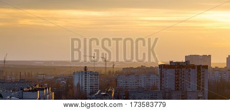 Top view from roof at Voronezh cityscape sunset, city, buildings at dramatic sky background, copy space
