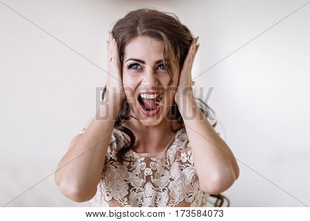 Portrait Of The Bride Shouts Loudly Covering His Ears With His Hands, Furious