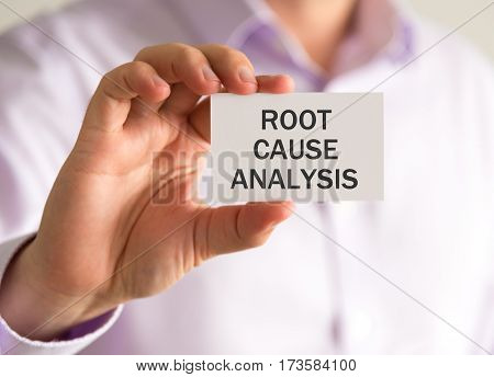 Businessman Holding A Card With Rca Root Cause Analysis Message