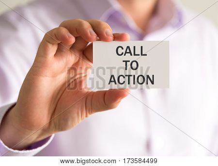 Businessman Holding A Card With Cta Call To Action Message