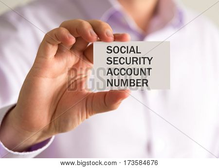 Businessman Holding A Card With Ssan Social Security Account Number Message