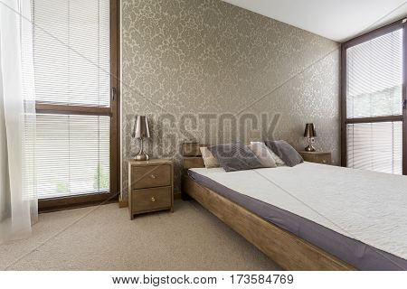 Stylish Bedroom With Wooden Decorations