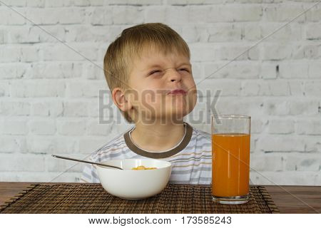 Funny little kid refuses to eat breakfast