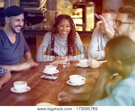 Group of people have a break at coffee shop