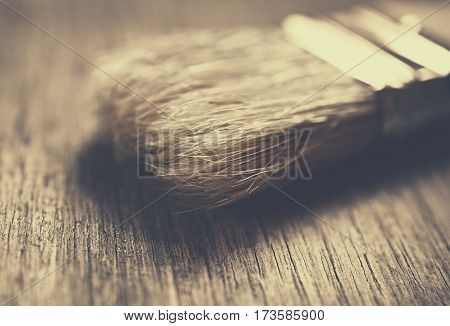Paint Brush on a Wood Surface, close up