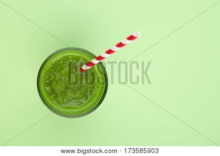 Fresh kiwi smoothie over green table for  background