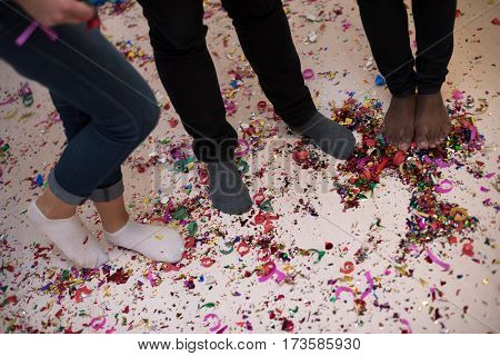 confetti party Multiethnics happy young people group celebrating new year eve while dancing and have fun at home