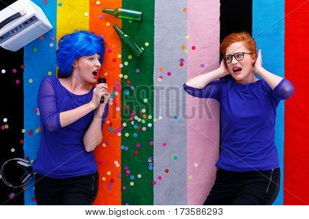 Ludic Girl Singing To Friend