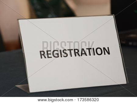 registration sign on the wooden table close up