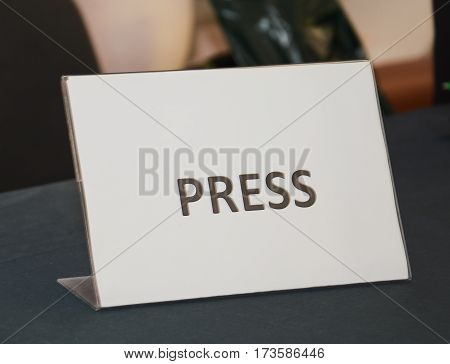 journalists sign on the wooden table close up