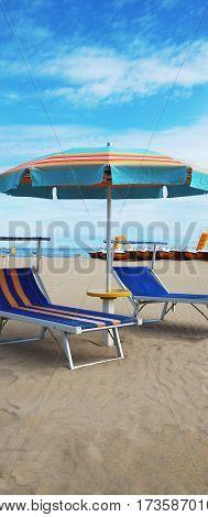 Chairs and umbrella on a beautiful sea beach