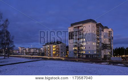 UMEA, SWEDEN ON FEBRUARY 14. View of a modern suburban settlement, buildings, street, walkway, traffic on February 14, 2017 in Umea, Sweden. Editorial use.