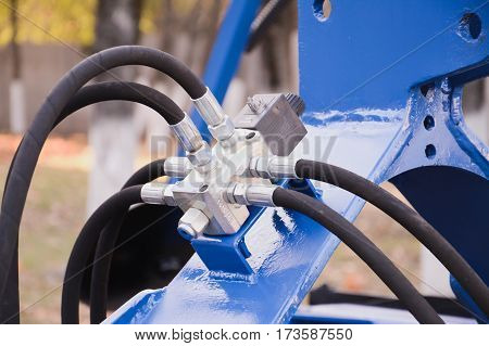 hydraulic wire on blue agricultural machine close up