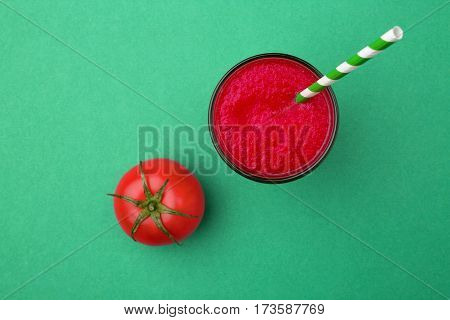 fresh tomato juice in the jar over green table