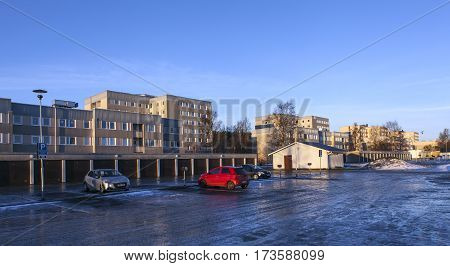 UMEA, SWEDEN ON DECEMBER 20. View of a modern residential settlement, car park, housing on December 20, 2016 in Umea, Sweden. Icy ground, sunset and winter. Editorial use.