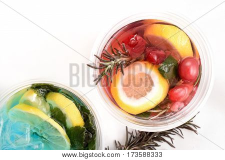 Glass of cherry soda with ice and fresh mint and lemon on rustic wooden background