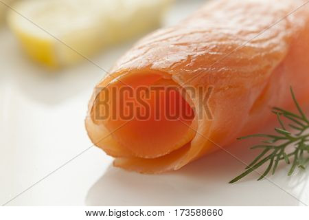 Roll of smoked salmon close up as a snack