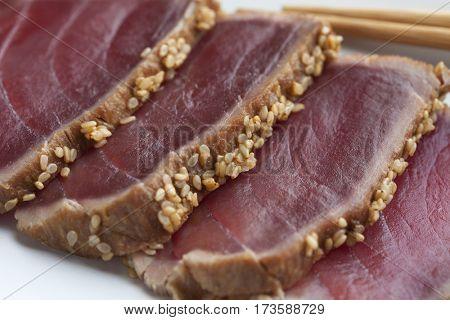 Tuna Tataki sashimi with sesame seeds close up