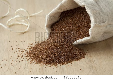 Little open linen pouch with teff seeds