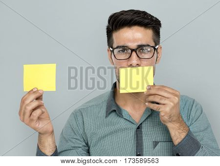 A man with post-it on his mouth