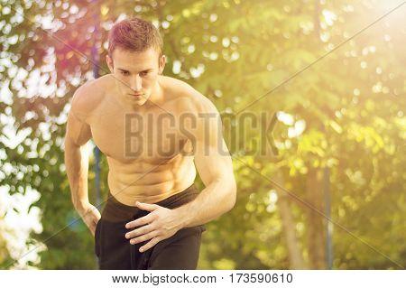 Handsome Athletic Man in Running Start Position