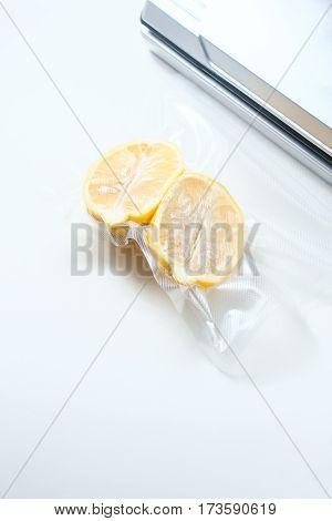 Lemon In A Vacuum Package. Sous-vide, New Technology Cuisine.