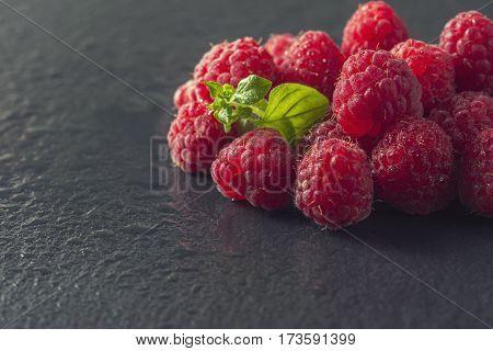Frame Of Fresh Sweet Raspberries With Water Drops On Black Backg