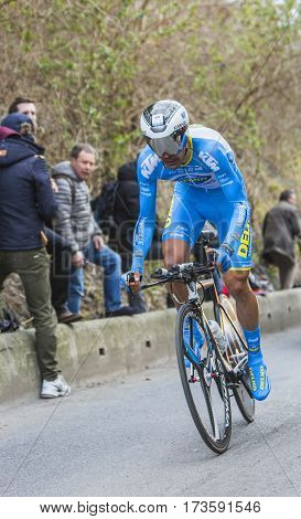 Conflans-Sainte-HonorineFrance-March 62016: The Spanish cyclist Delio Fernandez Cruz of Delko-Marseille Provence-KTM Team riding during the prologue stage of Paris-Nice 2016.