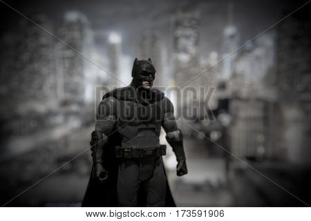 Batman DC Multiverse Series action figure standing in front of a Gotham City backdrop