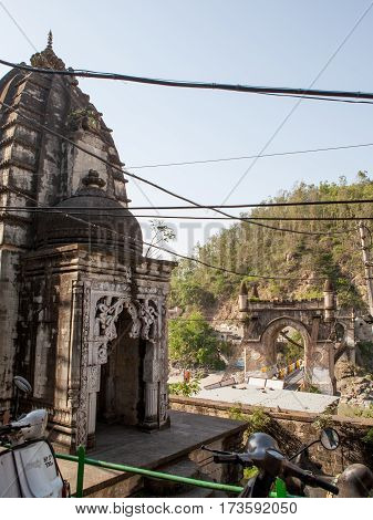 MANDI, INDIA. 4 Jun 2009: an Ancient Hindu temple and the old suspension bridge Victoria in Northern India . Mandi, Himachal Pradesh, India