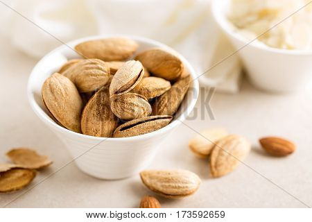 Almond nuts in a bowl on white background healthy eating