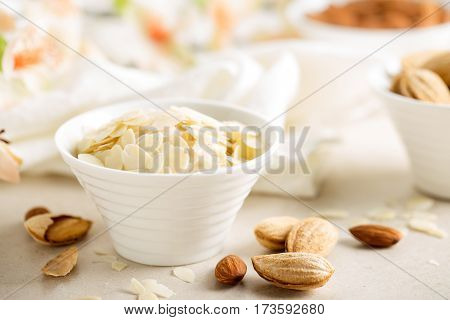 Almond nuts shavings in a bowl on white background healthy eating