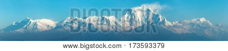 Dhaulagiri panorama blue colored panoramic view of Mount Dhaulagiri from Poon Hill view point round Annapurna circuit trekking trail Nepal poster