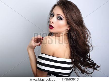 Beautiful Sexy Young Make-up Model Posing  With Streaming, Fly Away Brown Hair On Blue Background Wi