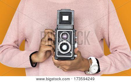 Girl Holding retro classic camera