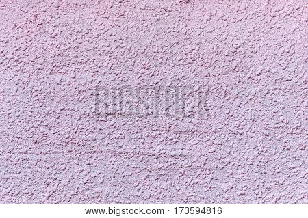 Relief plastered surface in muddy pinkish color. For background and texture.