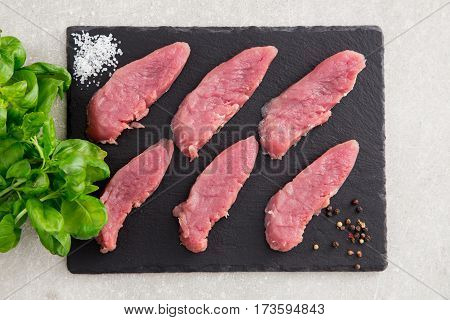 Raw Pork Meat On A Slate Board, On A Stone Background