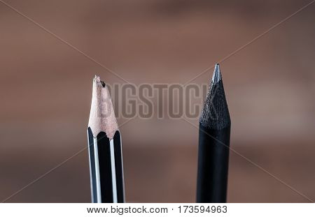 Close up sharp pencil and unsharp pencil blurred background low key tone