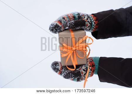 Gift In Hands In Winter