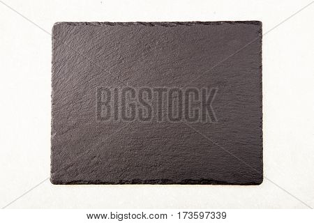 Textured Slate Board For Dishes On Light Background