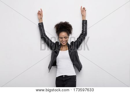 Happy African American woman with hands raised up