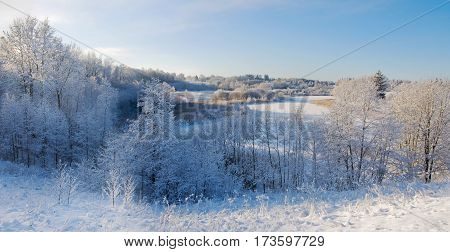 White and beautiful winter landscape with meadows and woods