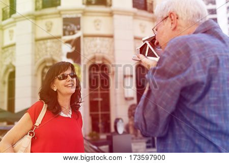Photo Gradient Style with Old guy taking a photo of his wife city background