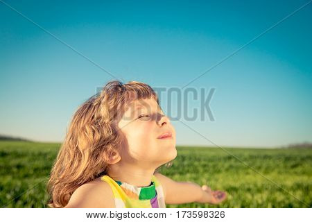 Happy Child Outdoors In Spring Field