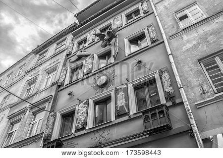 Lviv Ukraine - August 11 2016: Facade of restaurant House of Legends in Lviv. Black and white