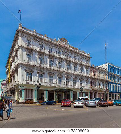 Havana, Cuba - April 1, 2012: Cubans Walk The Streets Of The Town Near Hotel Inglaterra