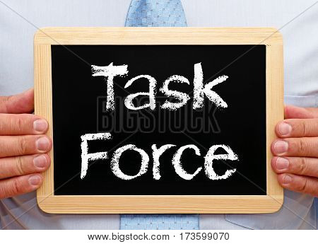 Task Force - Manager holding chalkboard with text