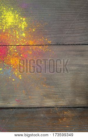 Holi colours on wood background. Celebrate festival Holi. Indian Holi festival of colours