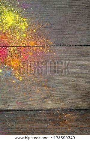 Holi colours on wood background. Celebrate festival Holi. Indian Holi festival of colours